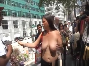Topless women in street