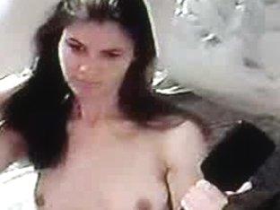 Naked brunette babe brushing her long hair naked