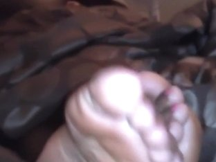 Caramel toes soles rubbing together