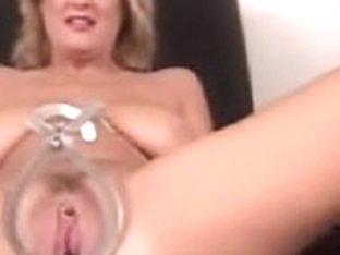 A doll and a monster speculum both in her pussy-wow!