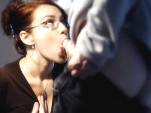 Redhead with really big bosoms does a sensual blowjob