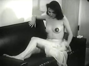 Dark Haired Woman on Couch