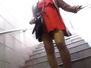 Girl in orange dress and tan stockings