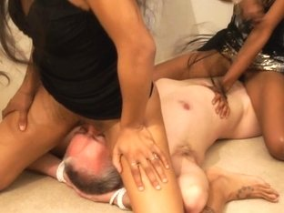 Ebony girl with wet tunnel of love sits on a guy's face