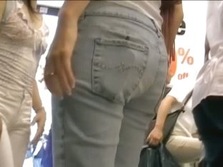 Candid street video shows a tempting Asian slut in the department store.