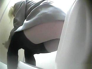 Woman secretly filmed in the public toilet