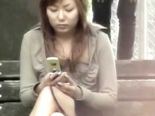 Public sharking shows a nice pair of tits on a Japanese gal