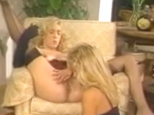 Lesbos take up with the tongue and toy the slits and booties