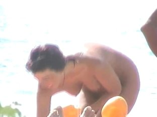 Short-haired mature woman filmed on hidden cam on the nude beach