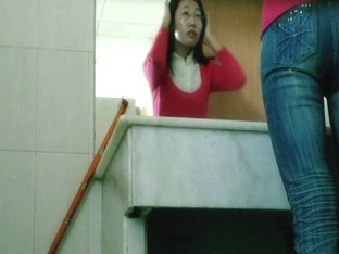 Hairy Asian taking a piss in the toilet on spy cam