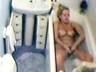 Hidden web camera of wife playing in washroom