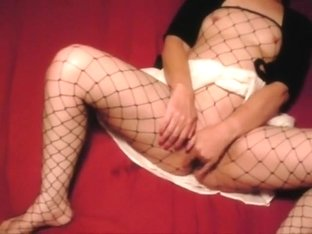 milf in fishnets masturbates to orgasm
