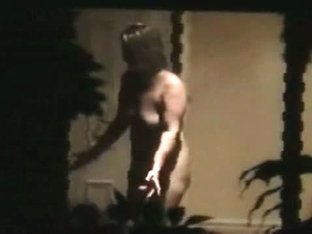 Nude fat blonde primps herself while being filmed thru her house window