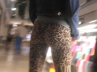 Teen in leopard leggings at the shopping mall