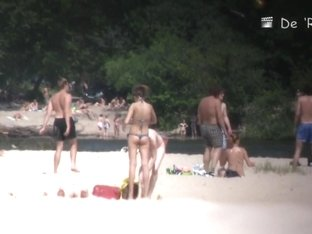 Beach nudist lying on the sand and showing his dick
