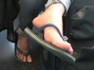 Candid feet on train 8