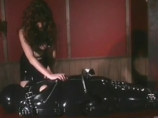 Redhead Sasha Sits On Latex Gimp S Face