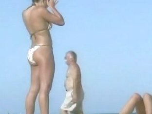 Candid beach video of a lusty girl getting her tan.