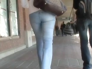 Delicious girl wearing tight jeans and filmed on spy cam