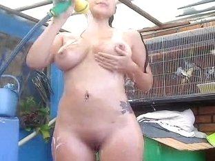 Outdoor showering of Latina babe on selfshot camera
