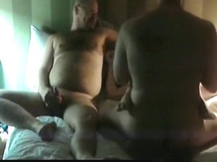 Cuckold like a boss. watching his wife getting fucked by a stranger next to him on the bed.