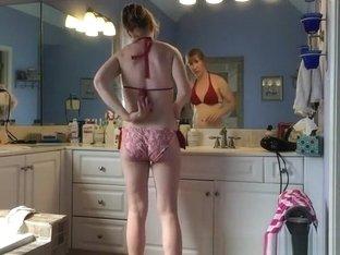 Woman caught taking off her red bikini