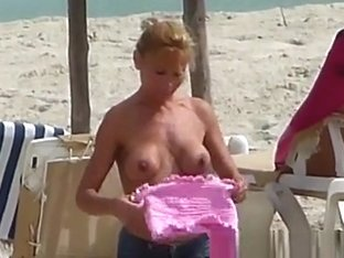 French Attractive topless blonde