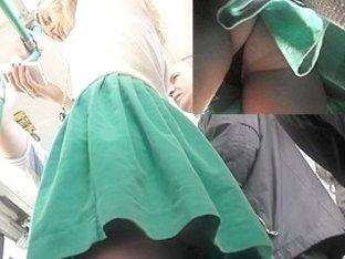 Spy upskirt cam got under the young chick's green skirt