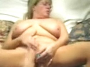 Naughty MILF shoves a blue sex toy in her fresh beaver