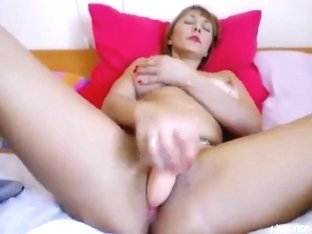 Redhead Beyba fucks her pussy with a rubber dildo