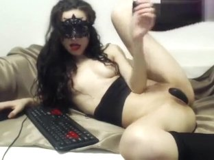 Black-haired Kendrasdream playing with a vibrator