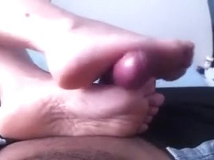 My lover shows her pedicured feet to me and gives me a footjob