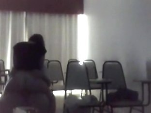 Teachers rides a student on a chair in the classroom