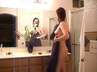 wife home alone taking a shower and masturbating with her fake penis
