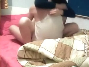 Homemade clip with an amateur Asian couple making love indoors
