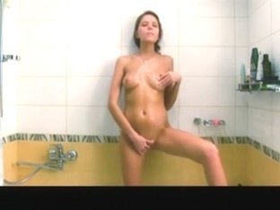 Lovely girl girl is playing with her gash in shower