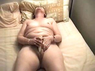 Fat granny plays with a big dildo
