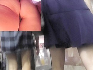 Two frolicsome girlfriends' upskirt by the voyeur