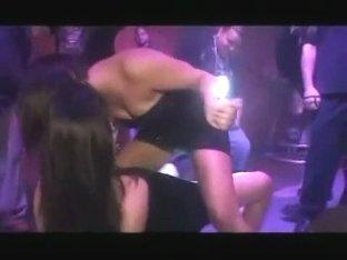 Two lesbians in short dresses dancing upskirt