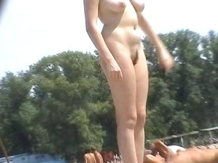 Nudist spy cam films a dark haired MILF in sunglasses