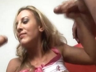 Blond strokes two big cocks till the cum