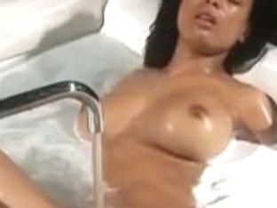 Curly busty Latina enjoys a hot bath