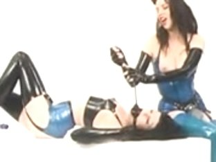 Brunette with strap on acts as latex lesbo mistress