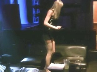 Girl in boots and nylons walks all over a man