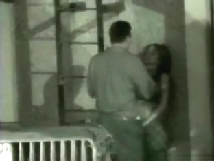 Voyeur tapes a party couple masturbating eachother in an alley