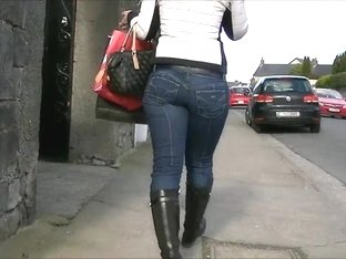 Candid blonde in tight jeans and boots