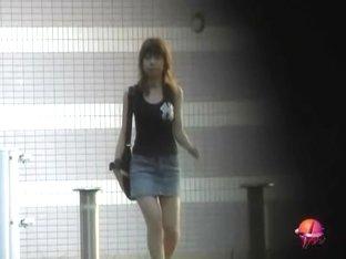 Hot oriental bimbo flashes her underwear when somebody pulls her skirt