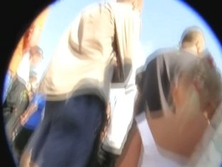 A skilful voyeur upskirt shot made in a large crowd