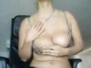 Big boobed aged sexy woman touching herself on web camera online