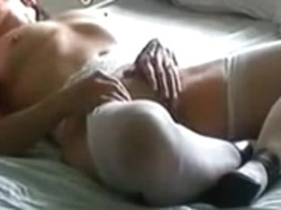 Hirsute wife rubbing with a rod in her face hole